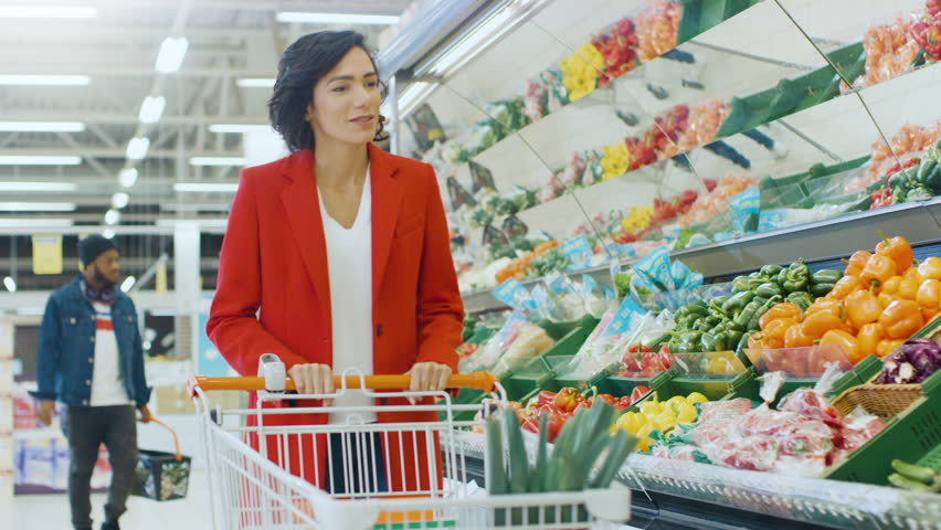At the Supermarket: Portrait of the Beautiful Smiling Woman Choosing Products In the Fresh Produce Section and Places them into Shopping Cart. Shot on RED EPIC-W 8K Helium Cinema Camera. | Shutterstock HD Video #1015805140