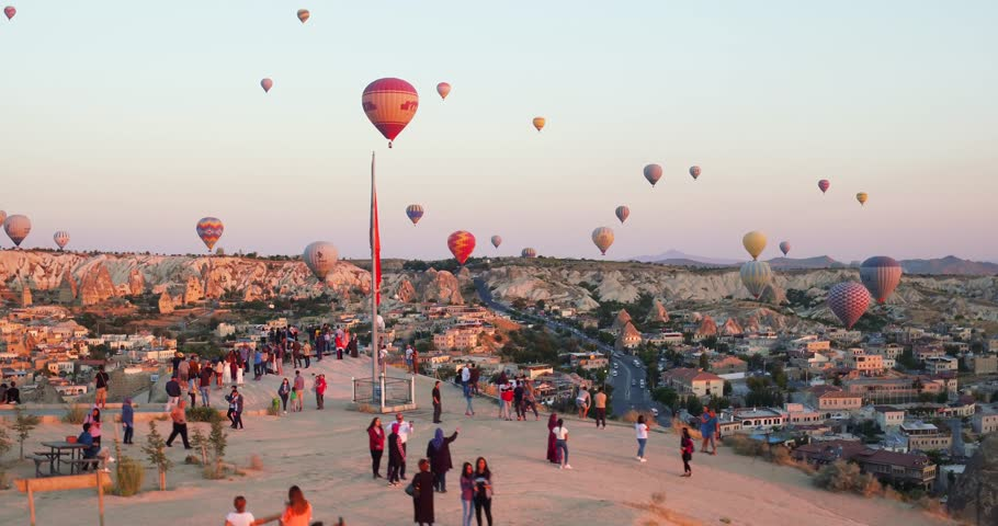 4K Aerial view of Goreme. Colorful hot air balloons flying over the valleys. Famous city Cappadocia, Turkey.