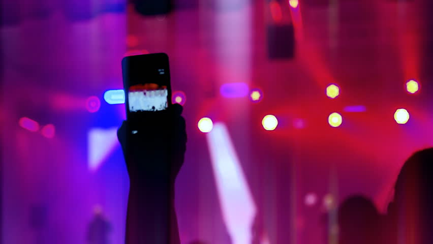 Record video on your smartphone at the concert   Shutterstock HD Video #1015844755