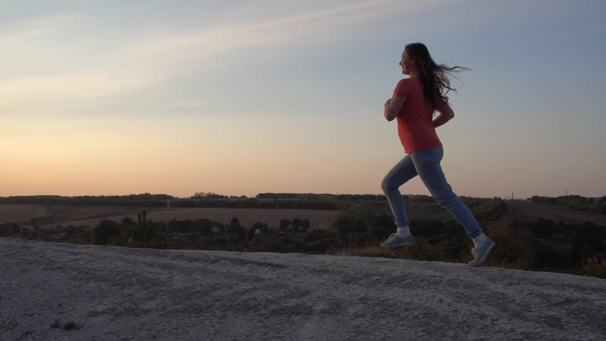 Girl Runs up the Mountain, morning  Exercising for health, slow motion, steadicam | Shutterstock HD Video #1015848313