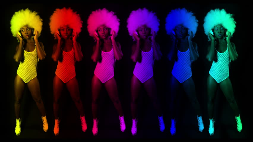 beautiful african female model in large afro wig dancing in white lingerie and headphones. multiple instance of the same model used to make cool abstract visuals