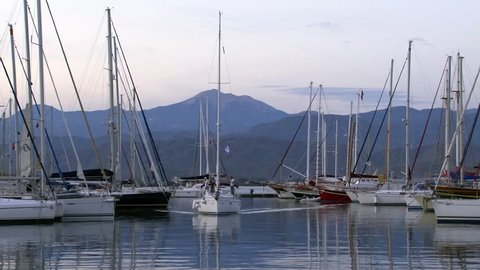 Marmaris, Turkey - September 12, 2010: Harbor of pleasure boats, craft and yachts in evening. Marine life style of travel by sea water.