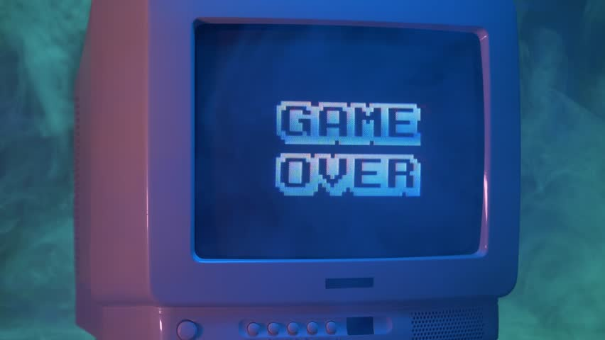 GAME OVER title on a tube TV Vintage 80's 90's arcade.Zooming out with fog giving a retro look at the scene.