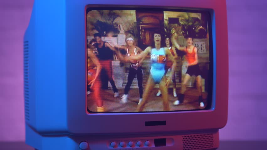 MONTREAL, CANADA - September 2018 : Vintage aerobic class with many trainers dancers on a old vintage TV screen 80s 90s style.