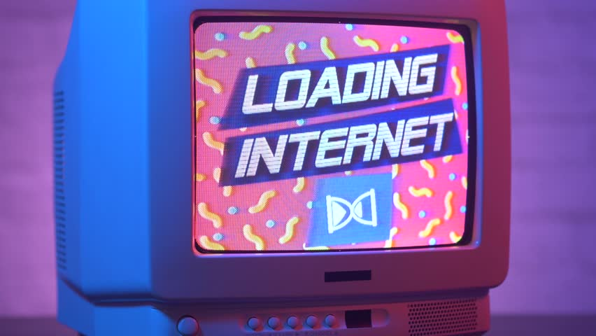 Loading the internet on an old vintage computer screen from the 90s. Retro style concept of the World Wide Web early moments. | Shutterstock HD Video #1015902019