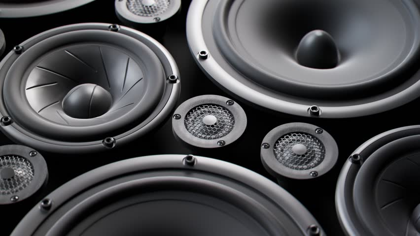 Vibrating speaker membranes stacked in an endless loop. Lit by soft, moody studio lights. Powerful, modern kind of midrange, subwoofer and twitter loudspeakers vibrate in even, pulsating frequencies.  Royalty-Free Stock Footage #1015905040