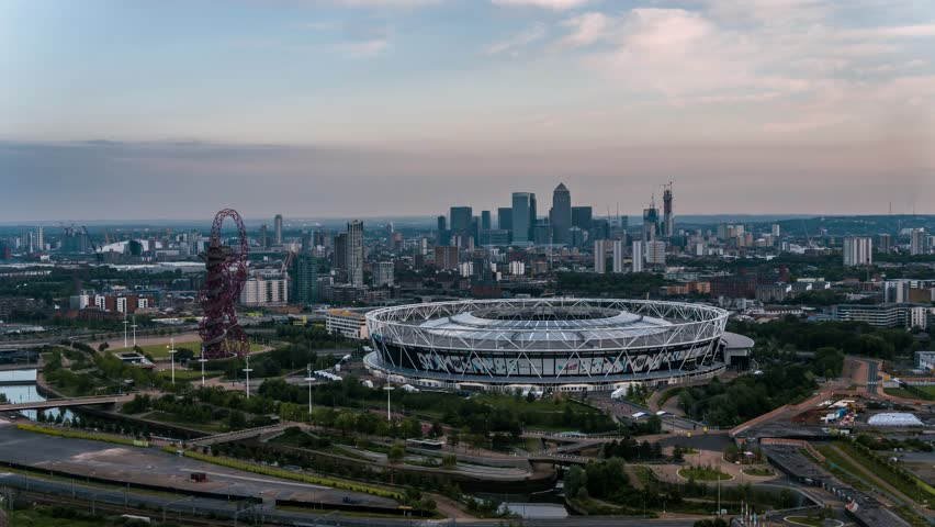 Aerial View of Olympic Stadium, West Ham, London Stadium, in backround Canary Wharf, London Financial District, London, United Kingdom