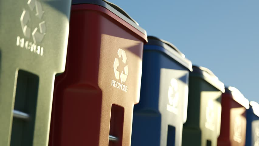 Colorful, plastic garbage bins, with recycle logo on the front, stacked in a row against a clear blue sky background in an endless, loop. Symbol of recycling, waste sorting and saving the environment. | Shutterstock HD Video #1015905763