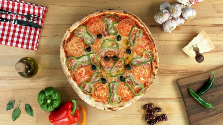 Served pizza, decorated with fresh basil. Top view, female hands.  | Shutterstock HD Video #10159121