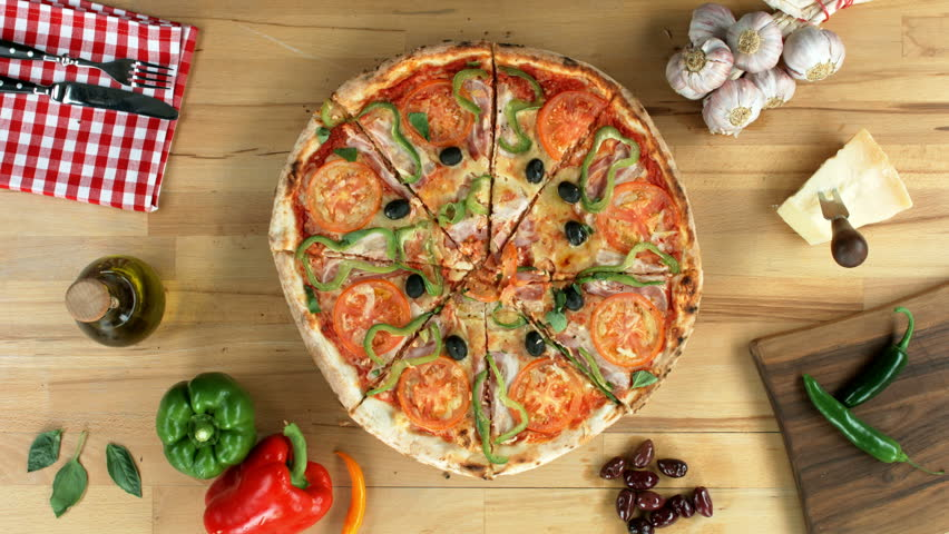 Sliced pizza served on a wooden plate. Female hands take one slice, top view.  | Shutterstock HD Video #10159127