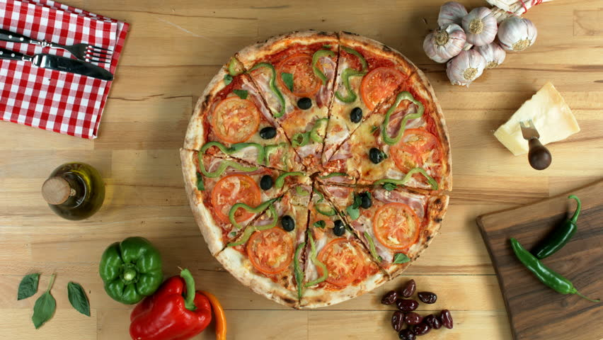 Sliced pizza served on a round wooden plate. Female and male (hands only) take all the slices.  | Shutterstock HD Video #10159133