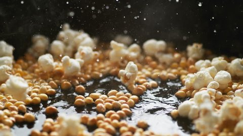 Popcorn popping on heated fry pan. Shot with high speed camera, phantom flex 4K. Slow Motion.