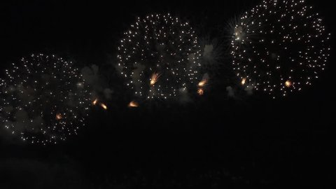 Beautiful colorful fireworks display for celebration on the black background, New year holiday concept stock footage video