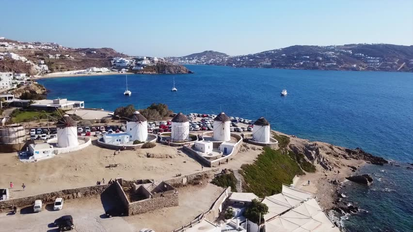 Aerial drone, bird's eye view video of iconic windmills in Chora of Mykonos island next to little Venice, Cyclades, Greece   Shutterstock HD Video #1016020690