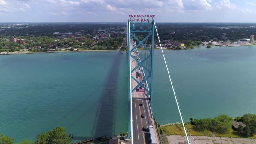 This video is of an aerial of the Ambassador Bridge in Detroit over the Detroit River. This video was filmed in 4k for best image quality.