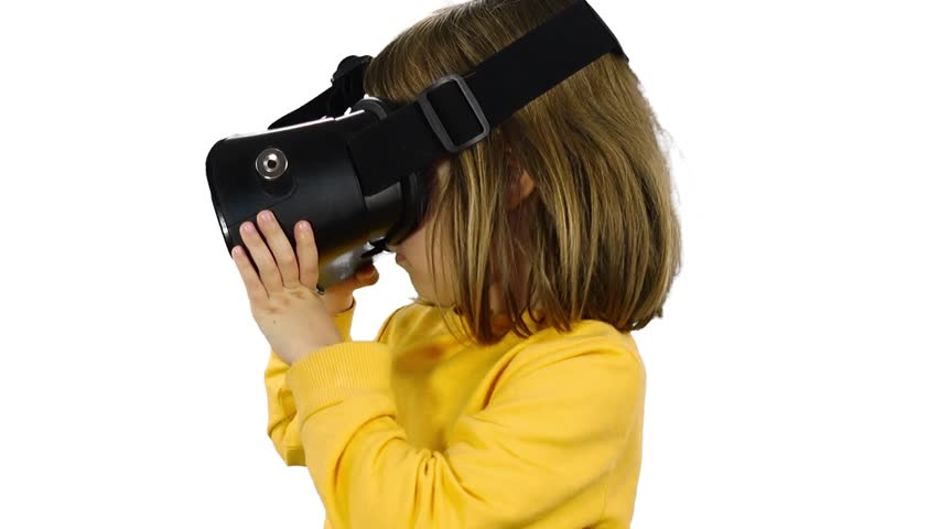 Little trendy funny girl wearing 3D virtual glasses headset. Child 4-5 years, caucasian, blonde. Happy child trendy entertainment concept. White studio background.