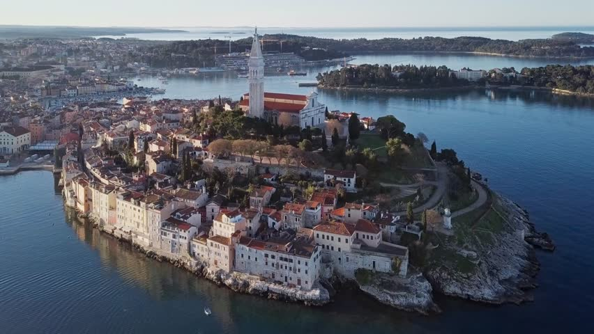 Morning aerial panorama of old town Rovinj, with reflection at the sea. Istria, Croatia.