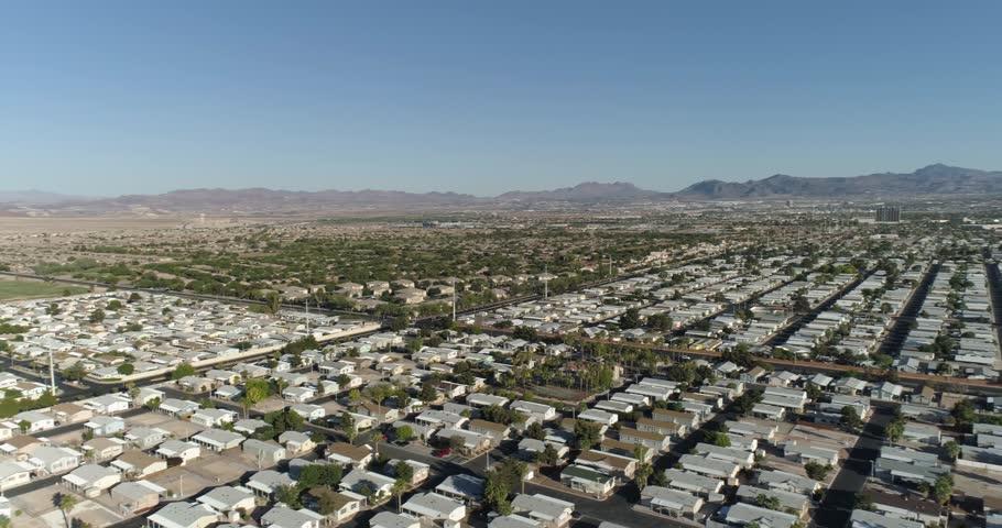 Aerial Drone Shot Panning Across Sunrise Mountain And Neighbourhood In Las Vegas | Shutterstock HD Video #1016024686