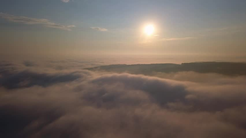 Aerial View of Flying Over Clouds at Sunrise   Shutterstock HD Video #1016038186
