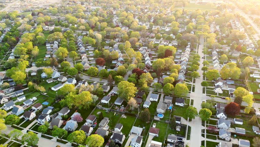 Aerial view of residential houses at spring (may). Establishing shot of american neighborhood, suburb.  Real estate, drone shots, sunset, sunlight, from above.  | Shutterstock HD Video #1016048158