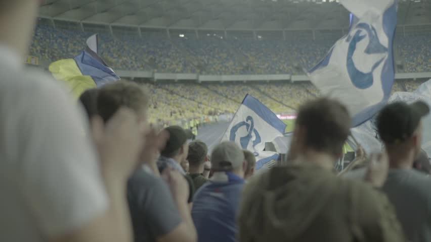 KYIV, UKRAINE – SEPTEMBER 2, 2018.  Fans at the stadium. Slow motion. | Shutterstock HD Video #1016051974