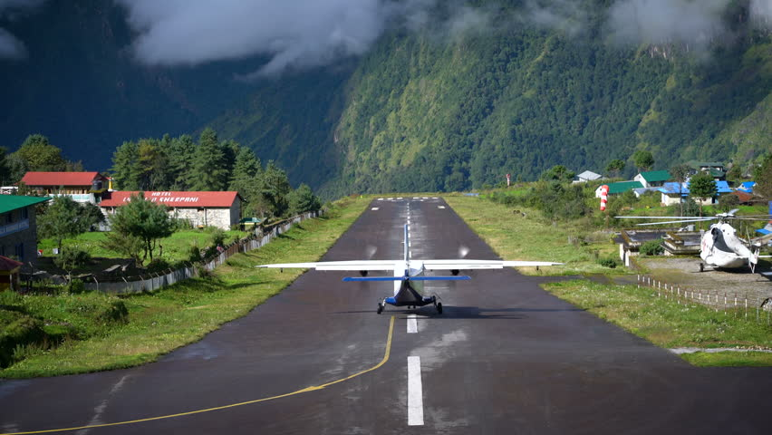LUKLA, NEPAL - 20 SEPTEMBER 2017: Aircraft Take off and Fly to Kathmandu Followed by Helicopter on Runway at Tenzing–Hillary Airport 4K