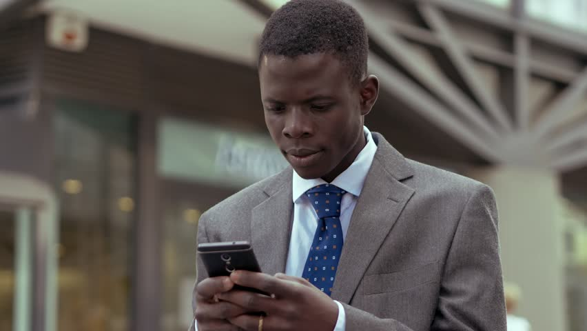 Success,winning.happy young black business man rejoicing for good news on phone | Shutterstock HD Video #1016064568