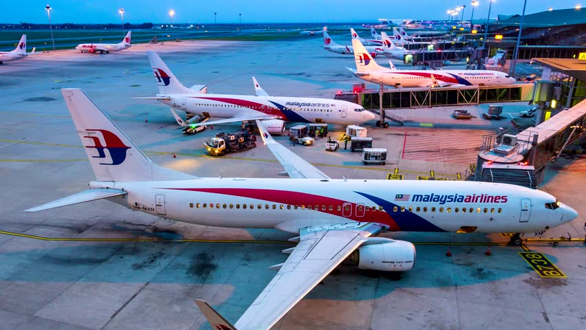 Kuala Lumpur, Malaysia - 8 Aug 2018 : 4k Time Lapse Day to Night Airplane Of Malasia Airlines Transportation In Kuala Lumpur International Airport (KUL) Kuala Lumpur, Malaysia