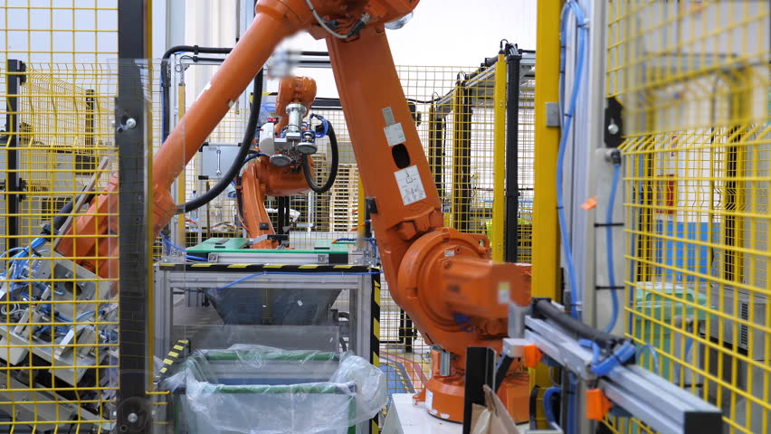 Industrial footage, 4.0 industrial revolution, robotic arm at work. Fully automated factory. Shot in 4K Royalty-Free Stock Footage #1016100064