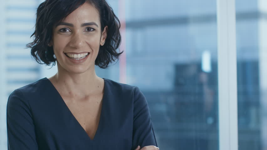 Portrait of the Successful Businesswoman Crossing Her Arms and Smiling. Beautiful Female Executive Standing in Her Office. Shot on RED EPIC-W 8K Helium Cinema Camera. #1016145796