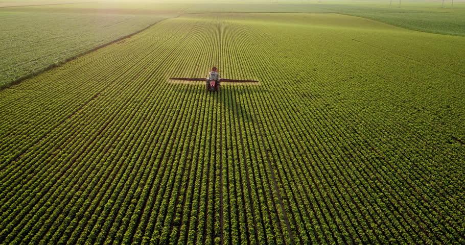 Aerial drone shot of a farmer spraying soybean fields #1016154853