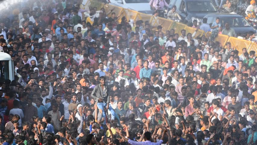 AMRAVATI, MAHARASHTRA, INDIA 3 SEPTEMBER 2018 : Crowd of young of People gather together and dancing on road during the Dahi Handi festival to celebrate God Krishna's Birth.    Shutterstock HD Video #1016157163