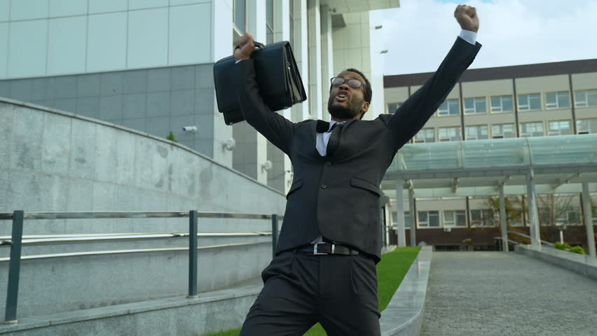 Extremely happy office manager shouting and dancing joyfully, promotion success