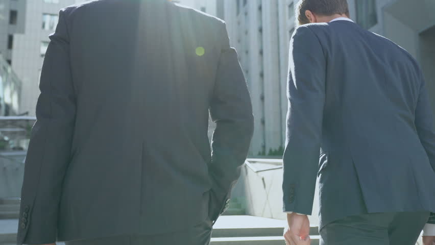 Business people walking upstairs, discussing startup, success in teamwork | Shutterstock HD Video #1016161639