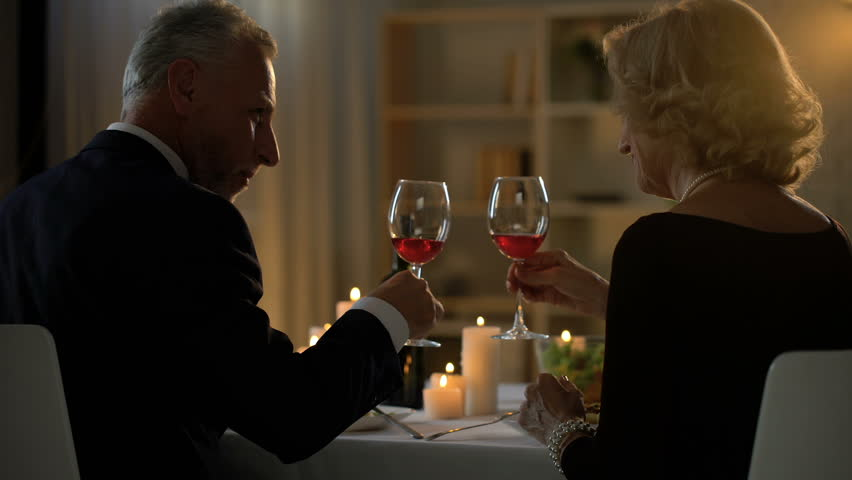 Senior happy couple eating dinner and drinking wine, anniversary celebration #1016161759