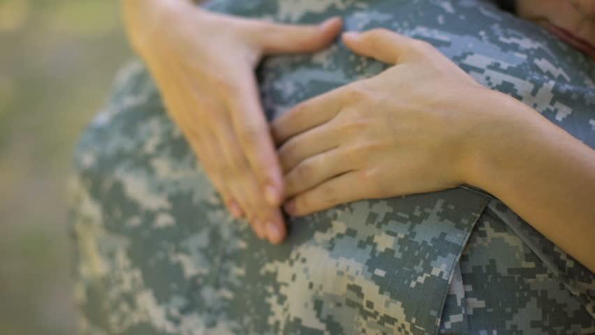Loving wife hugging airman boyfriend before leaving, military conscription
