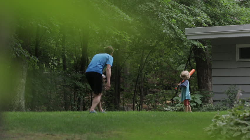 Cheerful father and son playing baseball at yard | Shutterstock HD Video #1016209156