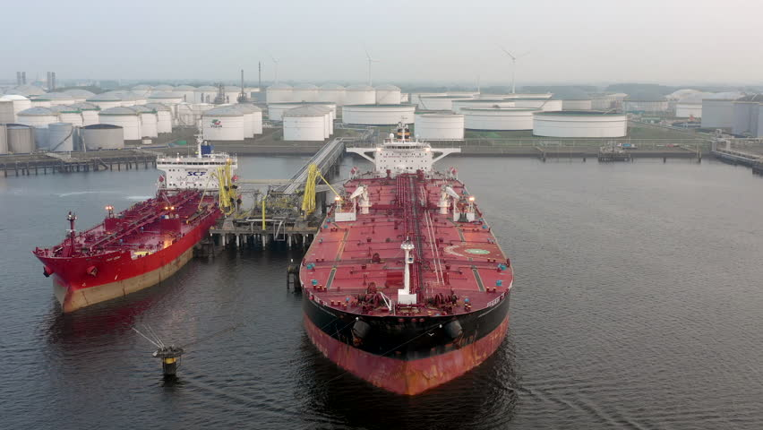LNG Supertankers Docked in Port Awaiting Offloading and Loading of Fuels and Cargo