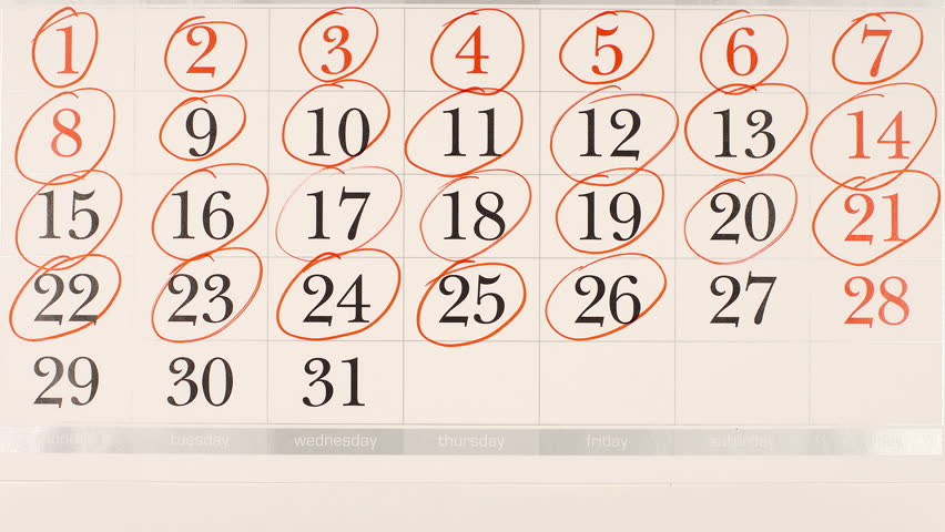 TOP VIEW: Marking (round) a numbers in a calendar - Stop motion