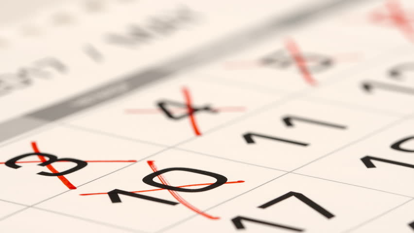 STOP MOTION: Crossing out (red marker) a numbers in a calendar - Macro