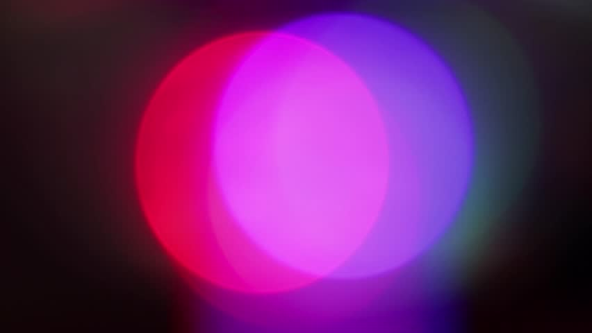 Looping video clip of moving out of focus colorful lights | Shutterstock HD Video #1016216653
