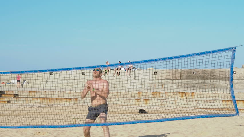 Men play volleyball on vacation. | Shutterstock HD Video #1016220547