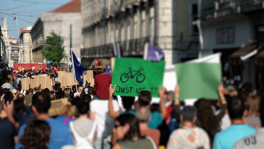 Climate Change March Europe. People worldwide demanding real climate action from their local leaders. Lisbon, Portugal | Shutterstock HD Video #1016228662