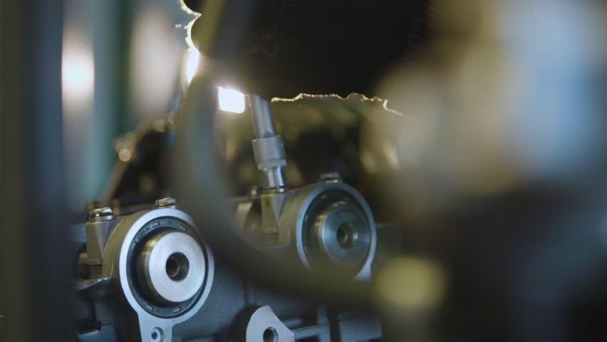 Slow motion close up of car engine disassembling. Service station mechanic