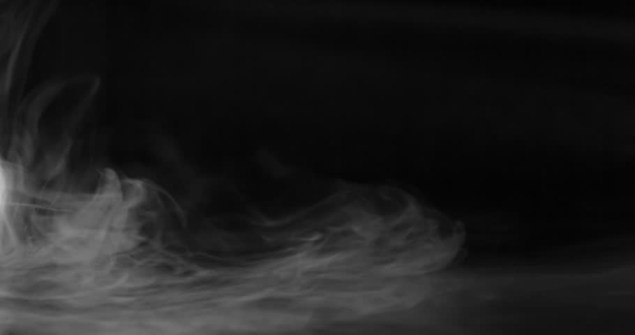 Falling and Current Smoke. Heavy white smoke slowly spreads over the black surface gradually dissolving. Slow Motion of 120fps | Shutterstock HD Video #1016229232