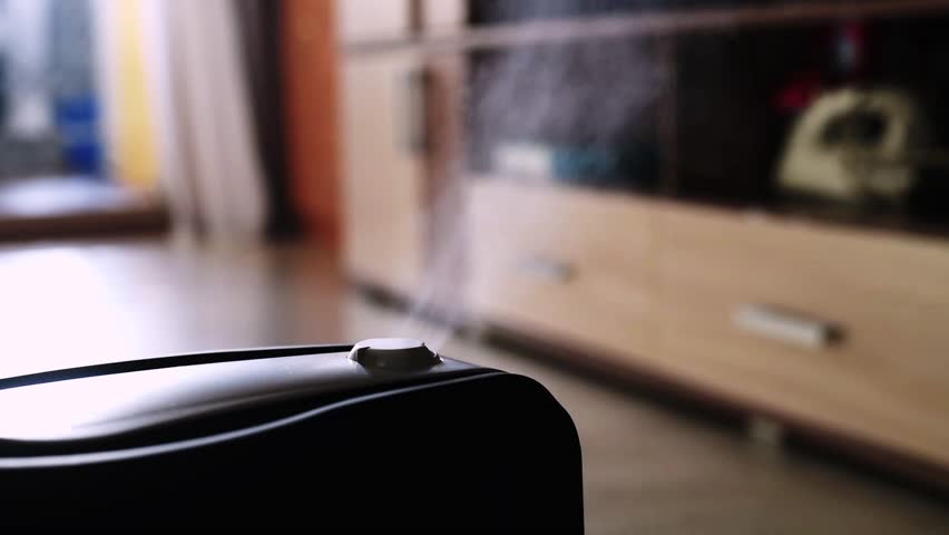 The steam from the humidifier in the night | Shutterstock HD Video #1016230294