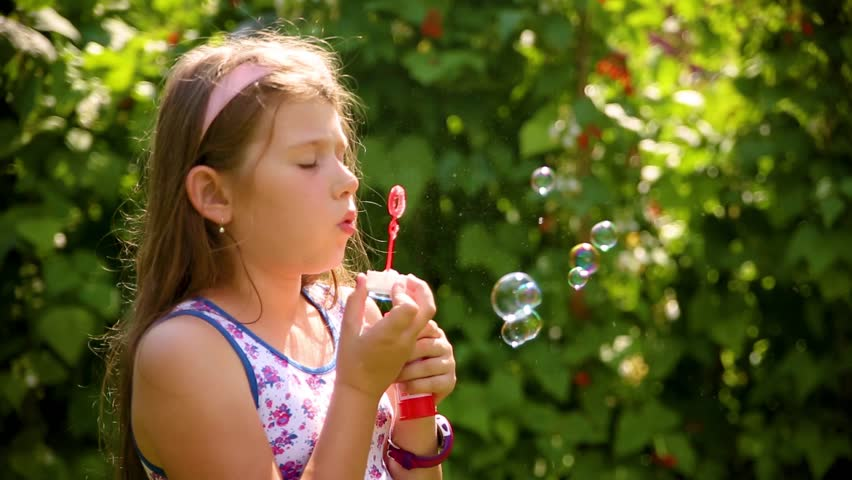 Shot Cheerful Little Girl Blowing Bubbles Stock Photo