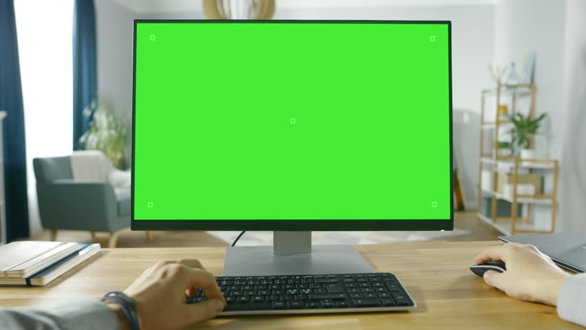 First Person View of Professional Freelancer Working on Green Mockup Screen Personal Computer From Home. Man Types, Browsing Through the Internet. Shot on RED EPIC-W 8K Helium Cinema Camera. | Shutterstock HD Video #1016262013