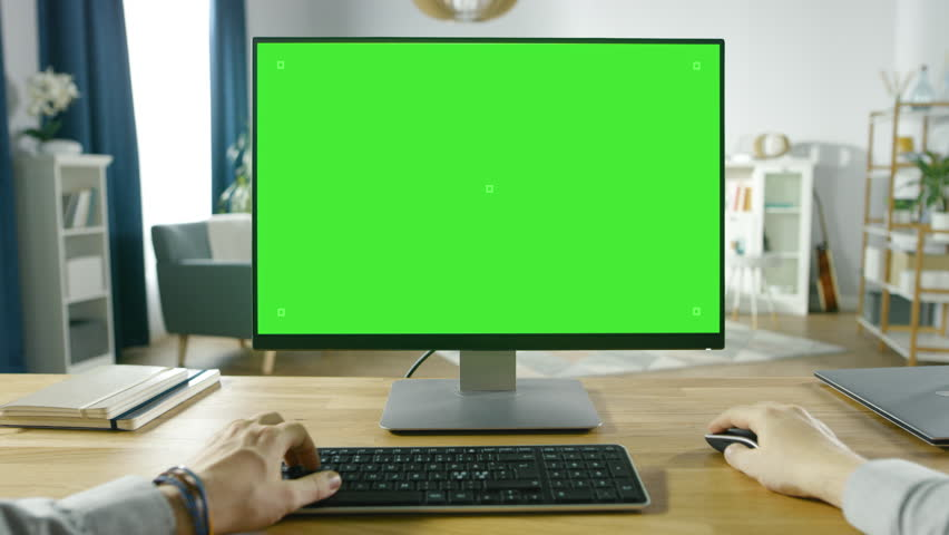First Person View of Professional Freelancer Working on Green Mockup Screen Personal Computer From Home. Man Types, Browsing Through the Internet, Using Computer. Shot on RED EPIC-W 8K Helium Camera. | Shutterstock HD Video #1016262022