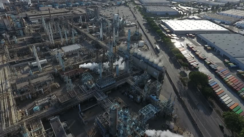 Aerial drone hovers over power plant | Shutterstock HD Video #1016290174